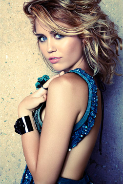 Miley Cyrus with blonde highlights and long hair