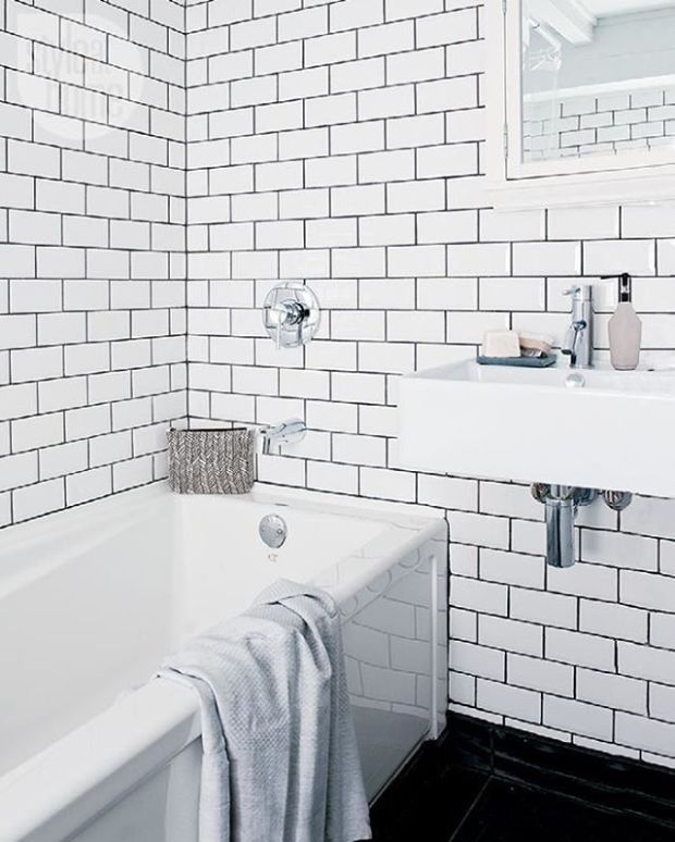 A bathroom that boasts floor-to-ceiling subway tiles with contrasting grout is 👌. See more at Interiors > House Tours Modern Monochromatic Victorian Home {Photo by: Angus McRitchie}