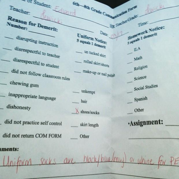 E's teacher gave him a demerit for wearing green socks on #StPatricksDay #ohyesshedid